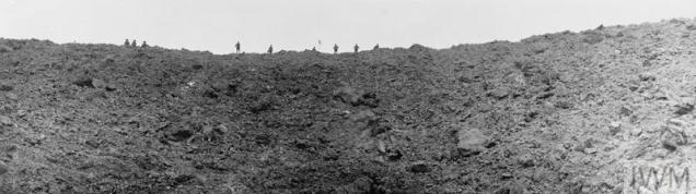 BATTLE OF MESSINES RIDGE, JUNE 1917 (Q 2325) British soldiers stand looking into the huge mine crater at Messines Ridge, blown up on the morning of the battle. Photographed on 11 June 1917 Copyright: © IWM. Original Source: http://www.iwm.org.uk/collections/item/object/205078334