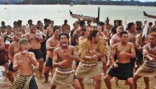 Landing of the whakas (canoes) and haka at Treaty grounds
